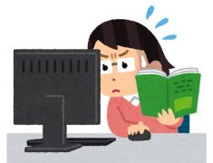 マニュアルを読みながらパソコンを操作している女性のイラスト